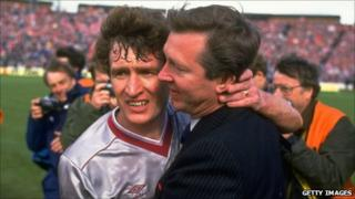 Alex Ferguson (right) Manager of Aberdeen hugs Sandy Jardine (left) of Hearts in commiseration after the Scottish Cup Final match at Hampden Park in Glasgow, Scotland. Aberdeen won the match 3-0.