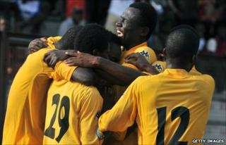 Asec Mimosas players celebrate earlier in 2011
