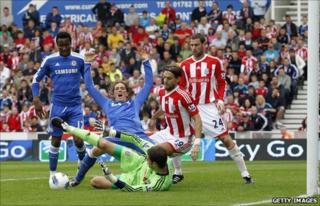 John Mikel Obi (left) in action for Chelsea against Stoke City on Sunday
