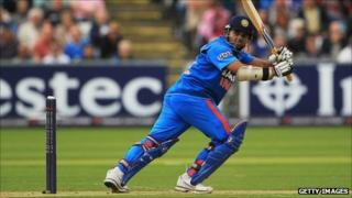 India's Parthiv Patel guides a shot to the leg-side boundary