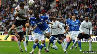 Tottenham Hotspur's Gareth Bale rises to head his first goal of the season