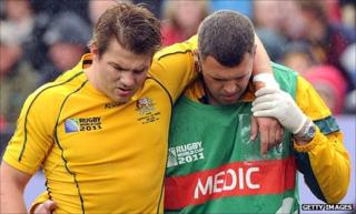 Drew Mitchell leaves the field injured against Russia