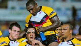 Stanley Gene is carried from the field after his final appearance for Papua New Guinea following their elimination from the 2008 World Cup