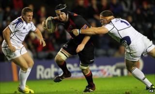 Edinburgh's Steven Turnbull is tackled by Leinster's Heinke van der Merwe