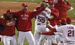 Winning pitcher Chris Carpenter (second left) joins in the celebrations