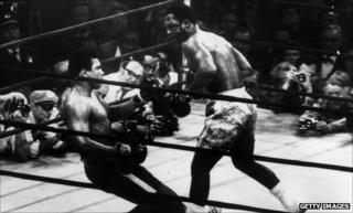 Joe Frazier floors Muhammad Ali in their first fight in New York