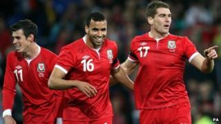 Sam Vokes (right) celebrates with Hal Robson-Kanu and Gareth Bale