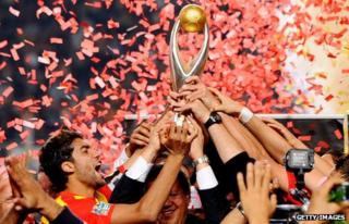Esperance captain Oussama Darragi holds the African Champions League Trophy aloft