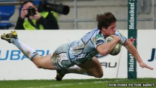 Blues scrum-half Lloyd Williams crosses for a try