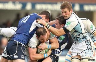 Leinster's Jonathan Sexton challenges as Graeme Morrison tries to force through