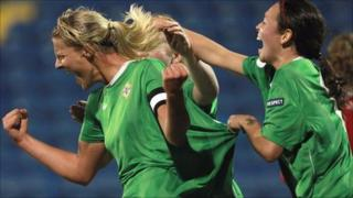 Ashley Hutton runs away in delight after scoring N Ireland's second goal