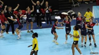Great Britain's players celebrate victory over Angola