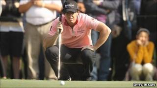 Rory McIlroy lines up a putt during the second round in Hong Kong