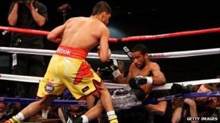 Lamont Peterson is knocked down