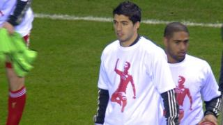 Luis Suarez and his Liverpool team-mates wear T-shirts of support