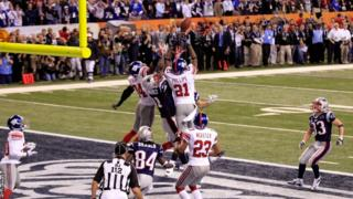 Aaron Hernandez of the New England Patriots is unable to catch the last play of the Super Bowl