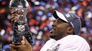 New York Giants wide receiver Hakeem Nicks with the Super Bowl trophy