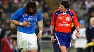 Martin Castrogiovanni is taken off after breaking a rib against England