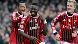 Sulley Muntari (middle) receives the backing of Robinho after his opening goal for AC Milan