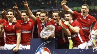 Wales celebrate victory at Twickenham