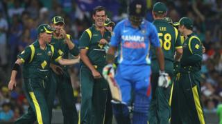 Australia celebrate dismissing India's Gautam Gambhir at the SCG