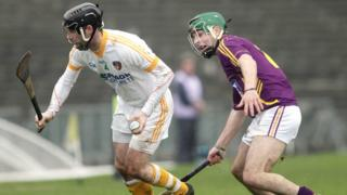 Kieran McGourty moves clear of Wexford's Gary Moore at Casement Park