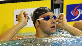 Ian Thorpe won his 100m heat but missed out on a place in the semi-finals