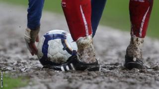 A muddy football pitch