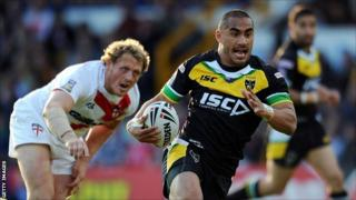 Thomas Leuluai runs clear of Ben Westwood during the International Origin match between England and Exiles at Headingley last June