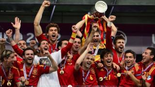 Spain players hold the trophy