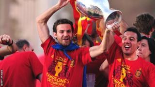 Juan Mata (right) lifts the Henri Delaunay trophy