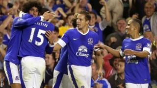 Everton celebrate Marouane Fellaini's winner