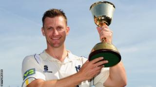 Warwickshire captain Jim Troughton with the County Championship trophy