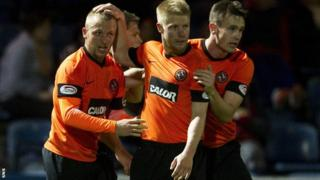 Dundee United celebrate after Johnny Russell (left) opens the scoring