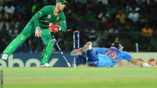 Suresh Raina dives to make his ground