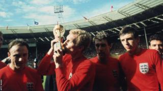 England captain Bobby Moore, whose image and name features heavily at St George's Park, with the World Cup in 1966