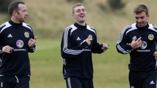 Scotland captain Darren Fletcher (centre) shares a joke with Charlie Adam and James Morrison