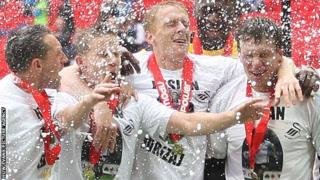 Swansea City celebrate promotion to the Premier League in May, 2011