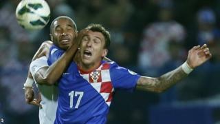 Wales' Ashley Williams challenges Croatia goal-scorer Mario Mandzukic