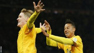 Rasmus Elm celebrates with his team mate Tobias Sana after scoring Sweden's late equaliser