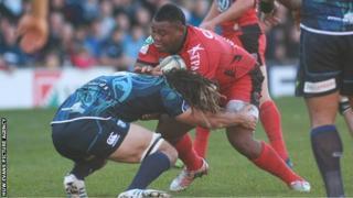 Toulon try-scorer Steffon Armitage is tackled by Blues' Josh Navidi