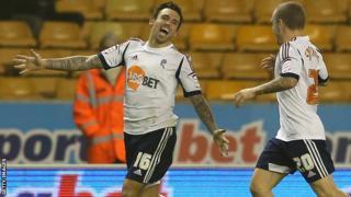 Mark Davies celebrates Bolton's equaliser
