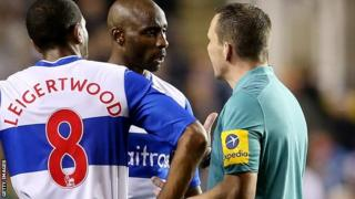 Jason Roberts of Reading talks to referee Kevin Friend during the Capital One Cup Fourth Round match between Reading and Arsenal