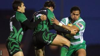 Connacht's Tiernan O'Halloran and Danie Poolman tackle Christian Loamanu of Treviso