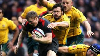 Chris Ashton of England evades Australian tackles