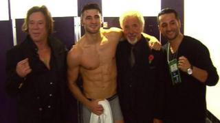 Mickey Rourke (left) and Sir Tom Jones flank Nathan Cleverly after his victory