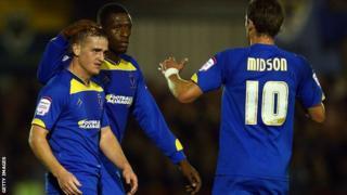 Charlie Strutton (left) celebrates his goal