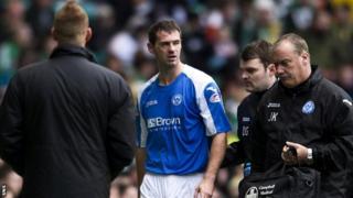 McCracken leaves the field at Celtic Park