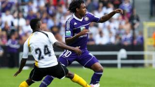 Patosi (left) playing for Lokeren against Anderlecht