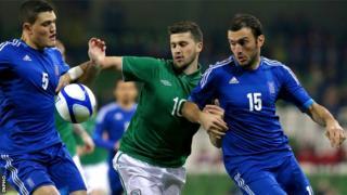 Shane Long battles with Kyriakos Papadopoulos and Vasilis Torosidis in Dublin